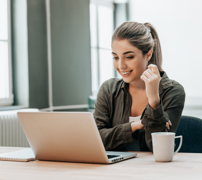 attentive-woman-watching-media-laptop-min